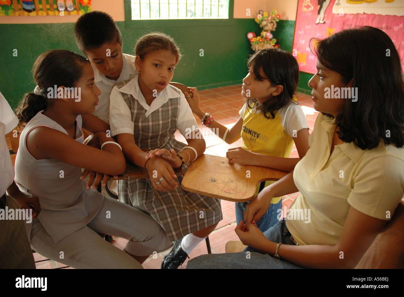 Painet iy8257 children kids teacher colombia extracurricular seminar middle school paz barrancabermeja discuss violence - Stock Image