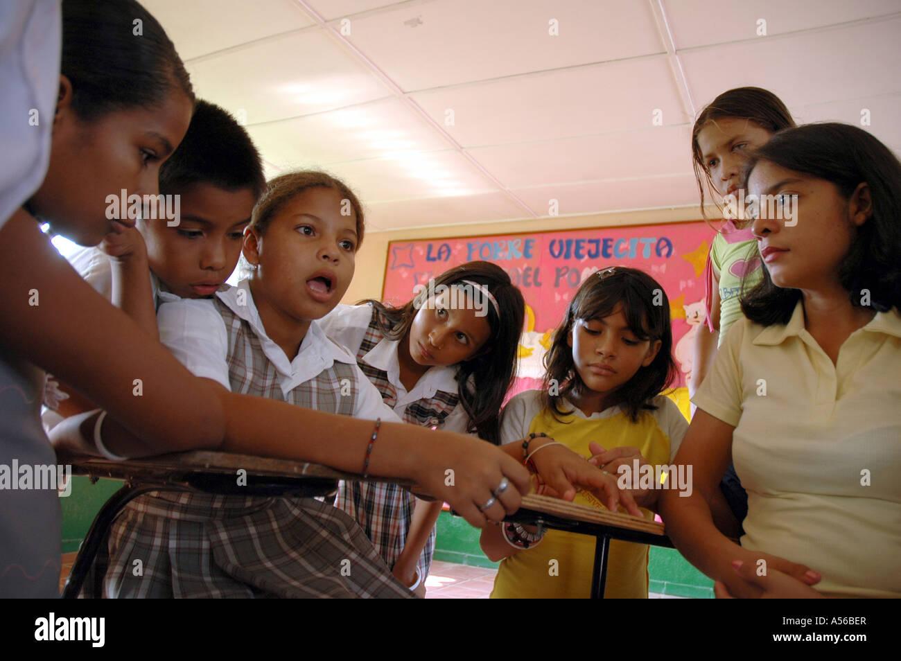 Painet iy8259 children kids female teacher colombia extracurricular seminar middle school paz barrancabermeja discuss - Stock Image