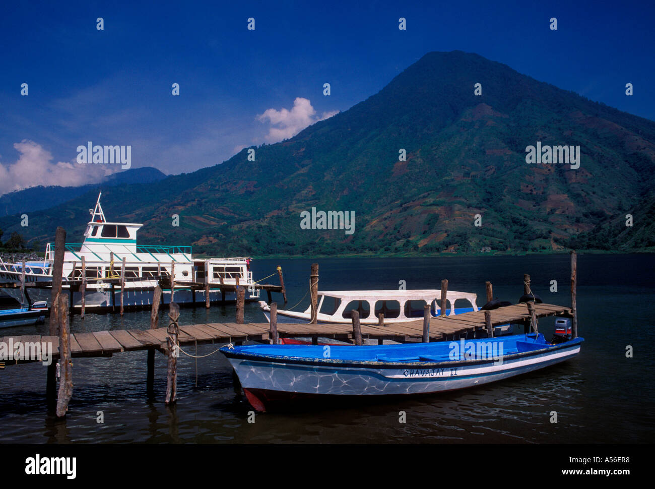 boats at dock, ferryboat service, town of Santiago Atitlan, San Pedro Volcano in the background, Solola Department, Guatemala, Central America - Stock Image