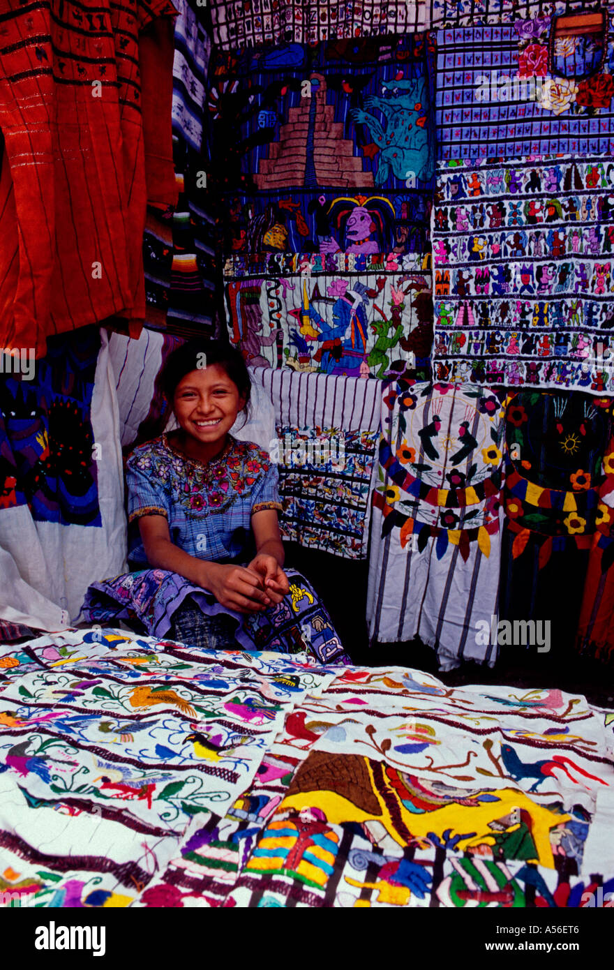 1, one, Guatemalan girl, Mayan girl, teenage girl, vendor, selling textiles, market stall, marketplace, Santiago Atitlan, Guatemala, Central America - Stock Image