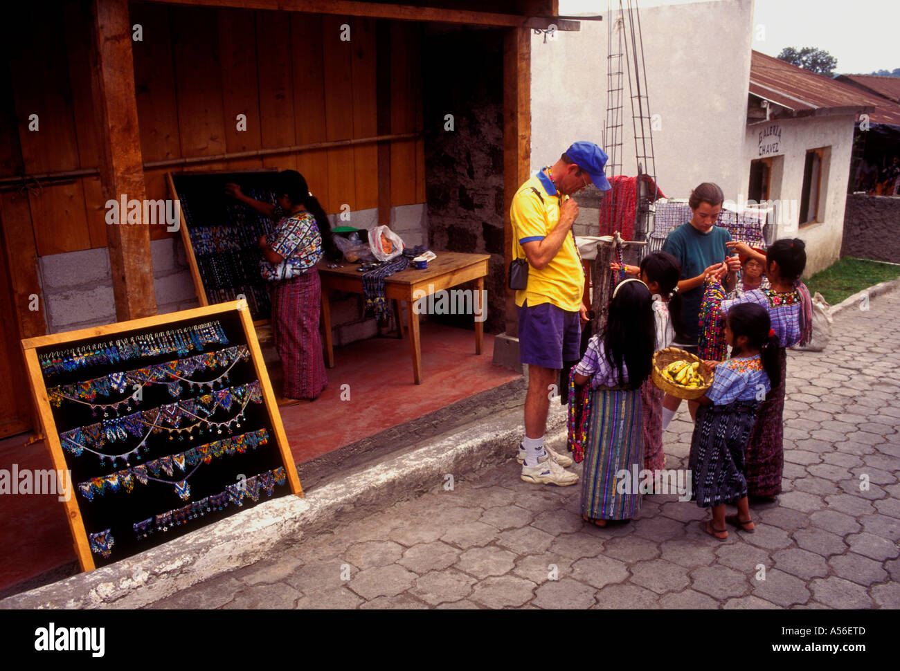Guatemalan girls street vendors selling to tourists in the town of Santiago Atitlan Solola Department Guatemala Central America - Stock Image