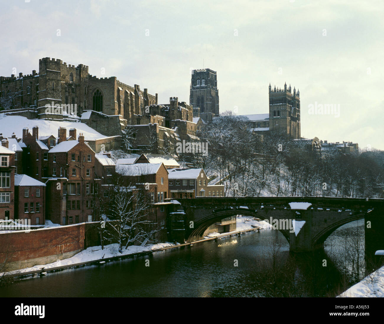 Snow Covered Cathedral And Castle Seen Over River Wear In Winter
