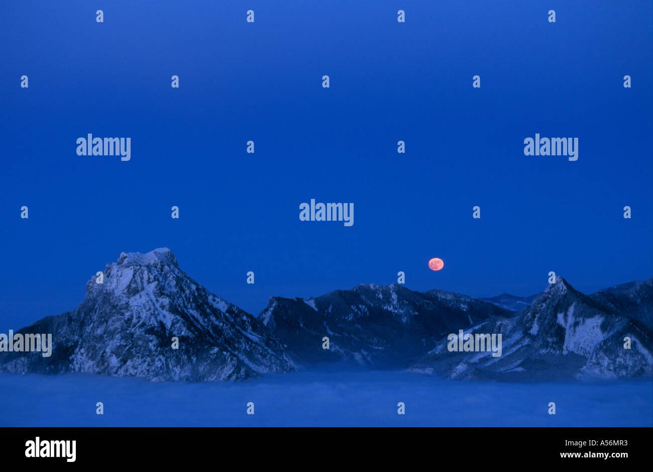 Moonrise Feuerkogel mountain Austria - Stock Image
