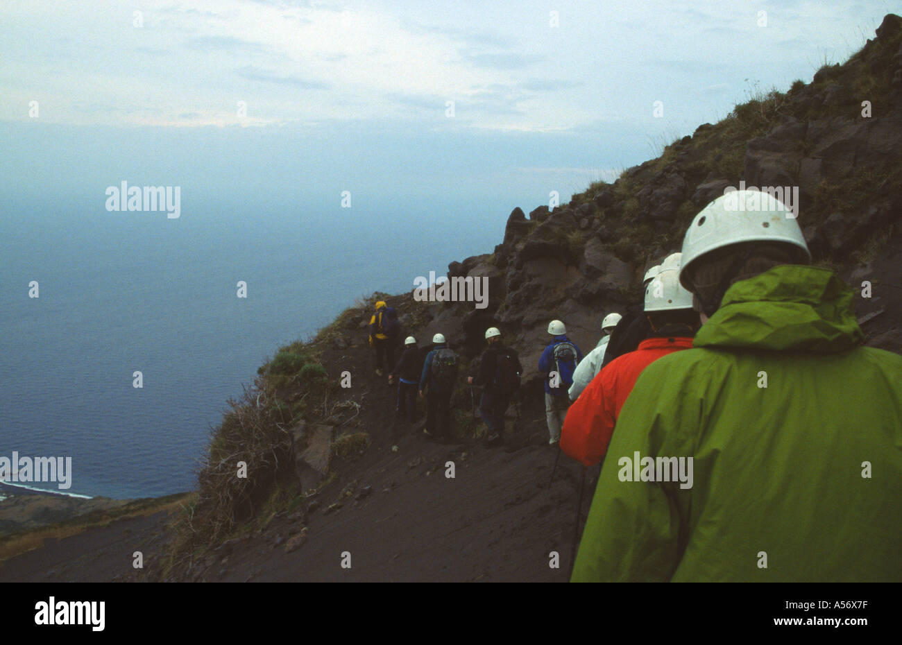 Walkers with volcanologist guide climbing Stromboli Volcano on island of Stromboli Sicily - Stock Image