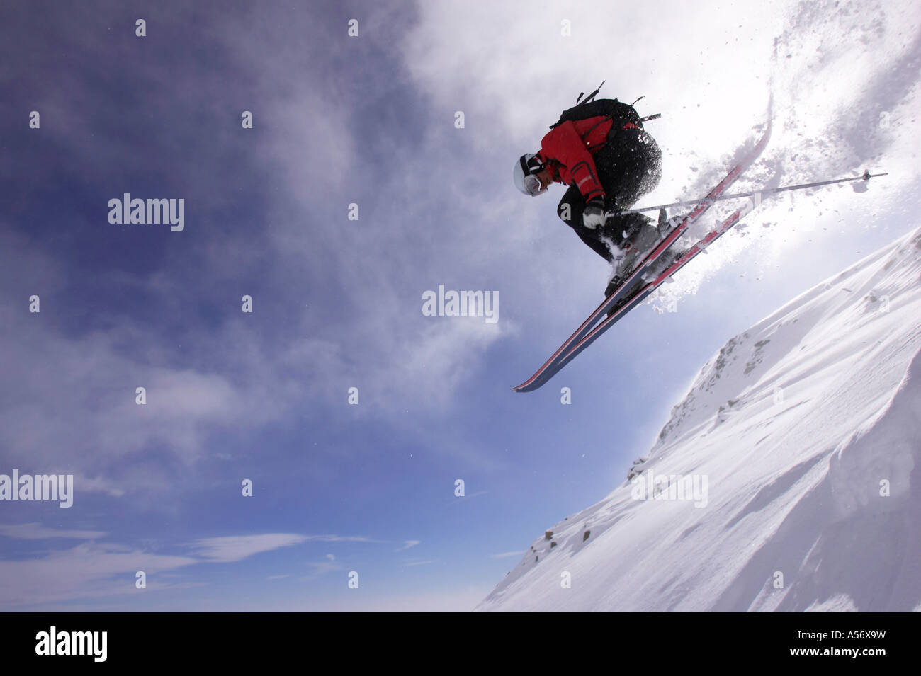 Italy, Gressoney, person jumping ski, low angle view - Stock Image