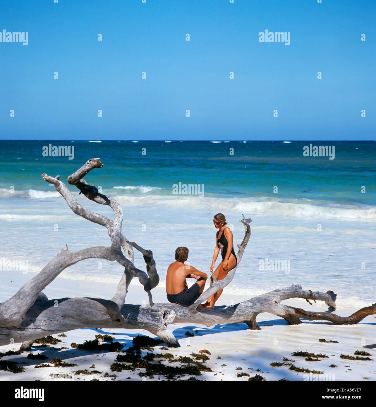 Couple on Diani Beach near Mombasa, Kenya, East Africa - Stock Image