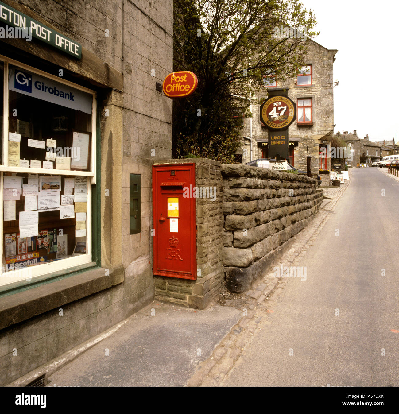 UK Yorkshire Wharfedale Grassington post box built into wall outside Post Office Stock Photo