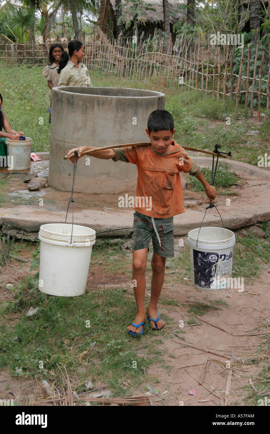 Painet je2209 cambodia day life boy 14 year old kun nob collecting water well kampot province 2006 labor labour Stock Photo