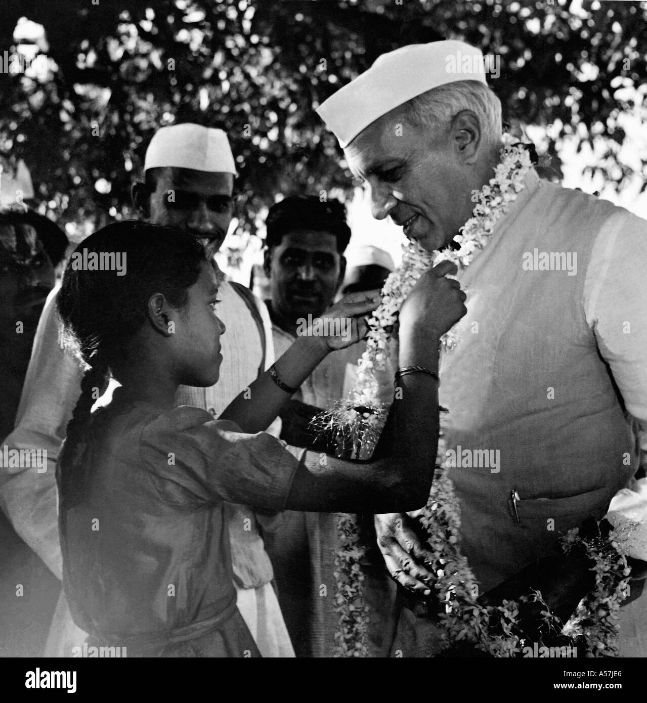 PCP030 Pandit Jawaharlal Nehru being garlanded by small girl on visit to rural India Uttar Pradesh India 1953 - Stock Image