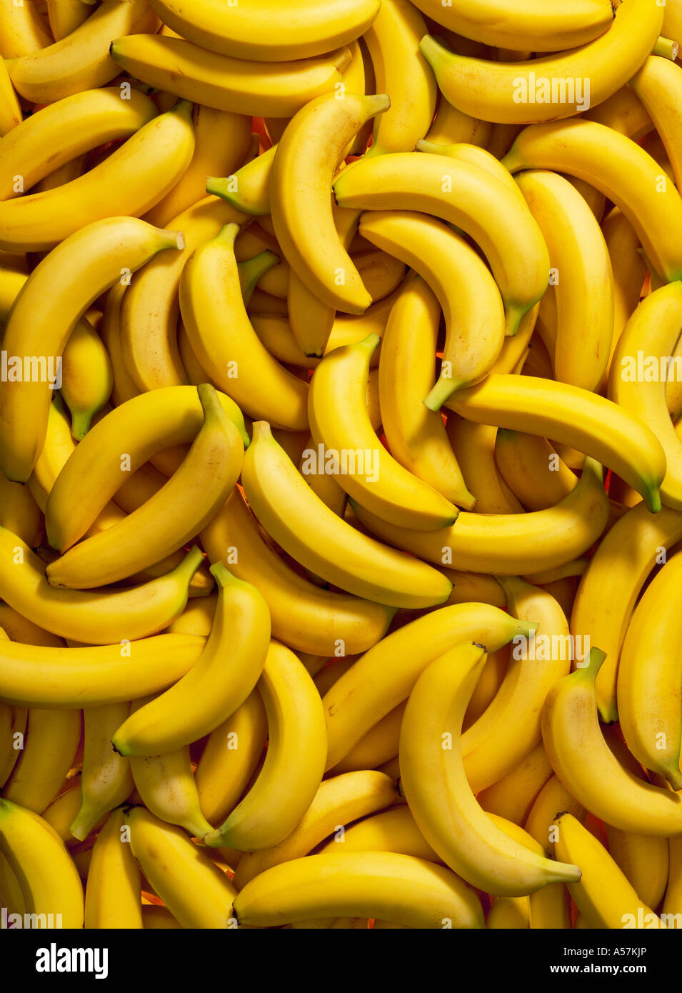 A pile of Bananas. Ideal as a backdrop or background - Stock Image