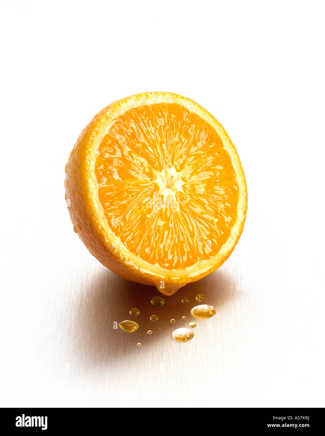 A juicy fresh Orange cut in half Stock Photo