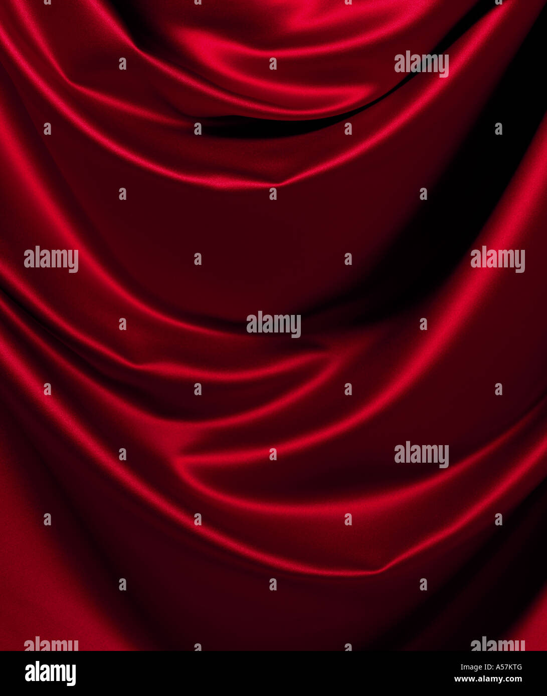 A piece of following red Satin, ideal as a background or backdrop - Stock Image