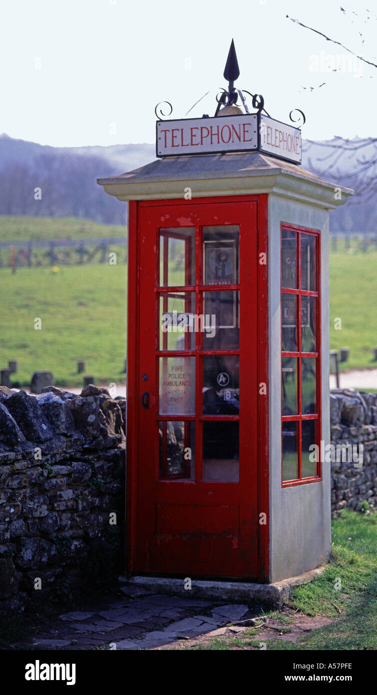 Old red pre world war 2 telephone box Tyneham Village Dorset England UK - Stock Image