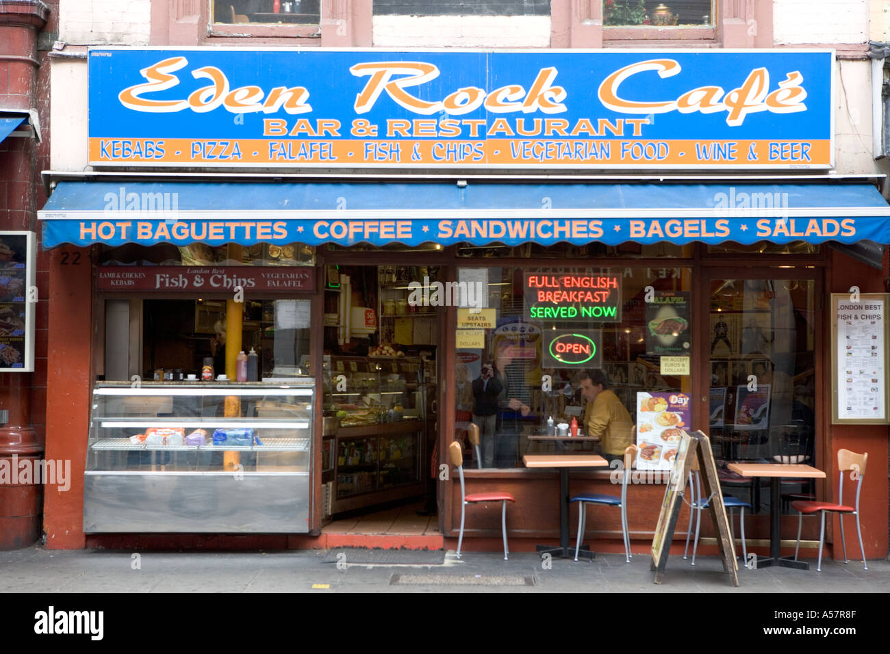 Cafe with diners and full English breakfast neon sign in London England - Stock Image