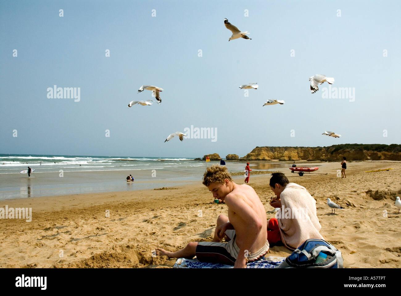 Two boys on surf beach Torquay Surf Coast nr Geelong Victoria Australia - Stock Image