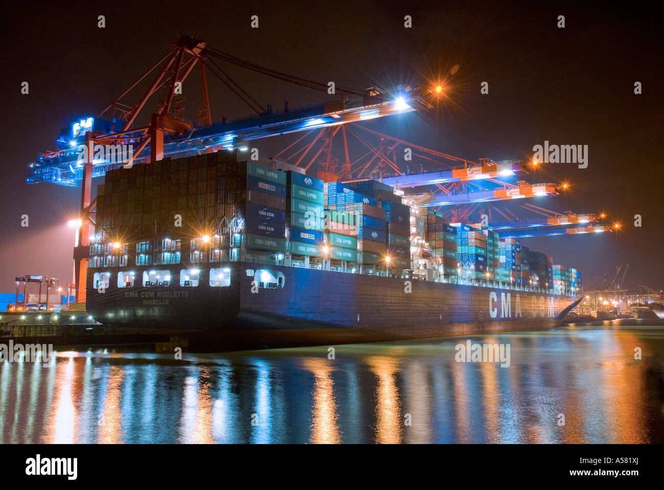 Large container ship lying at Hamburg Harbour at night, container ...
