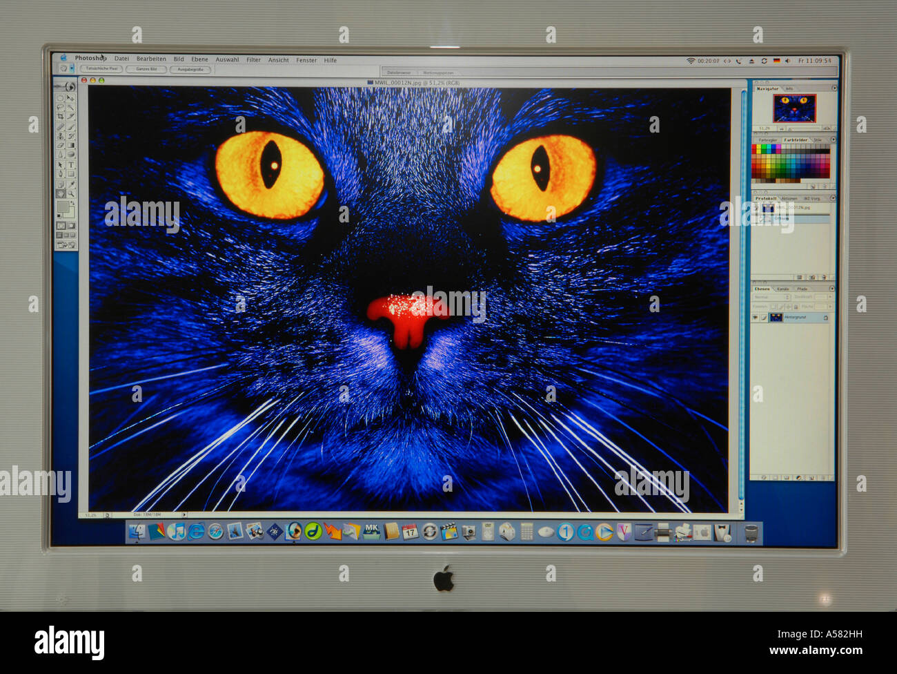 Digital composing with Adobe Photoshop on Apple Cinema Display Stock Photo