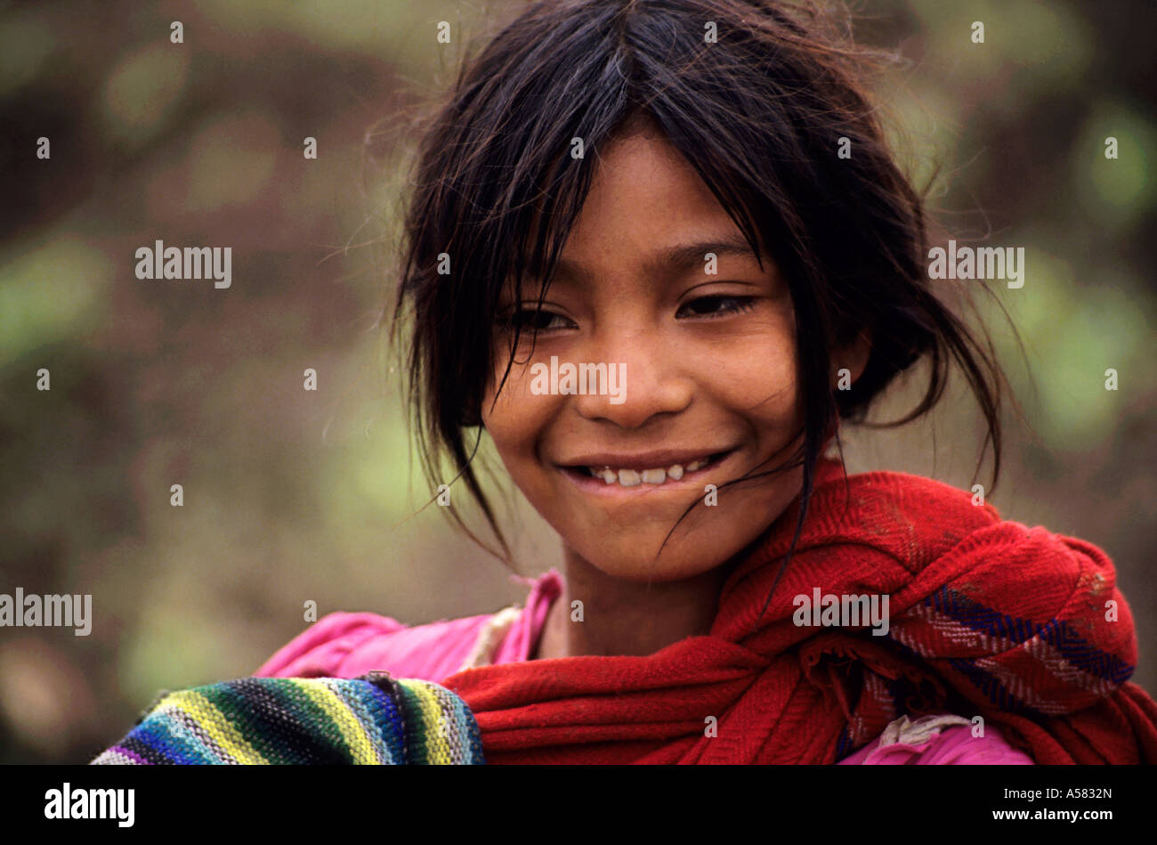 Portrait of a smiling Guatemalan girl at a refugee camp, Chiapas, Mexico. - Stock Image