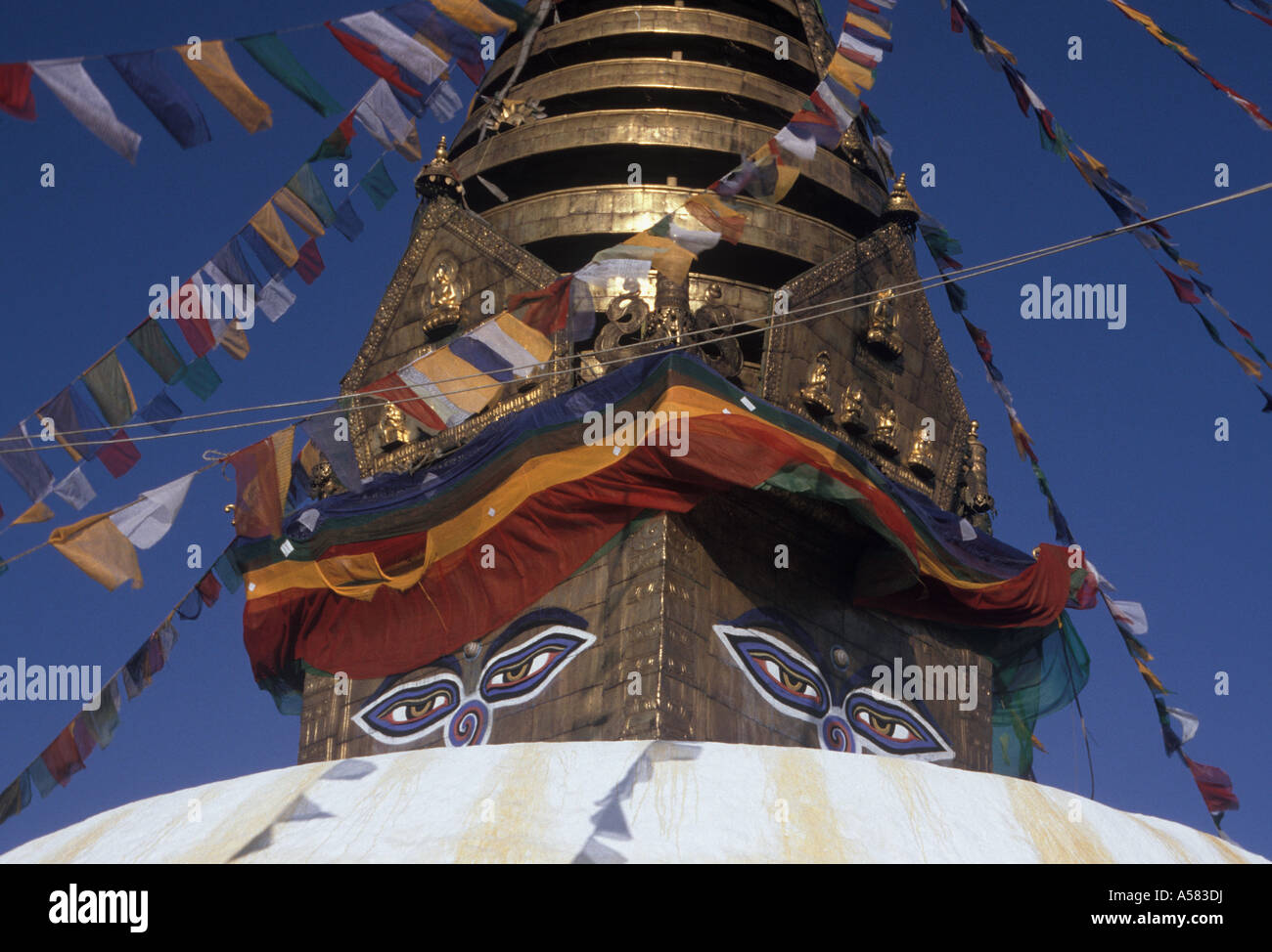 Partial view of the great Stupa of Svayambunath, with prayerflags and the 'all seeing eyes ot Buddha', Svayambunath, - Stock Image
