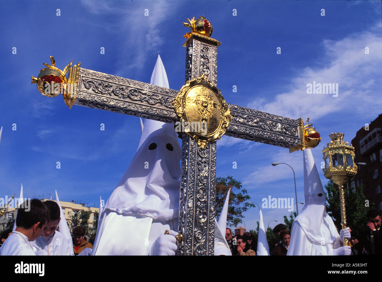 Procession , penitents with cross , Semana Santa , Holy Week , Easter , Granada , Andalusia , Spain , Europe - Stock Image