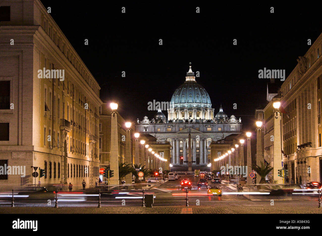 Night shot with lit street and St. Peter Cathedral, Rome, Italy, Europe - Stock Image