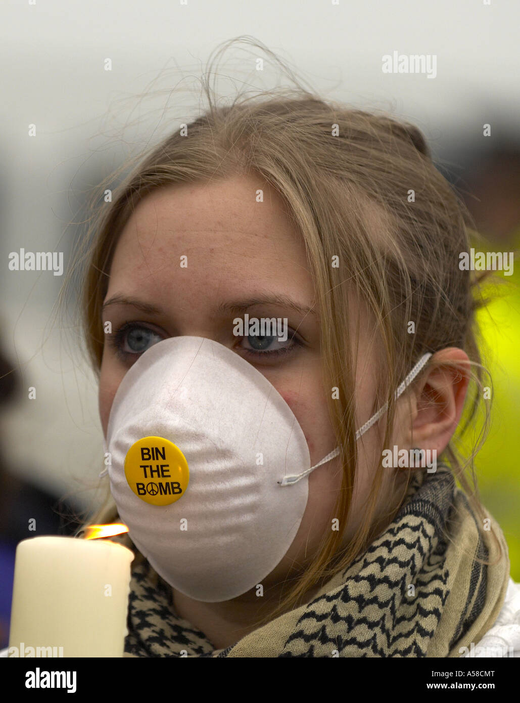 Protester holding a candle at anti nuclear protest at Faslane Naval base - Stock Image