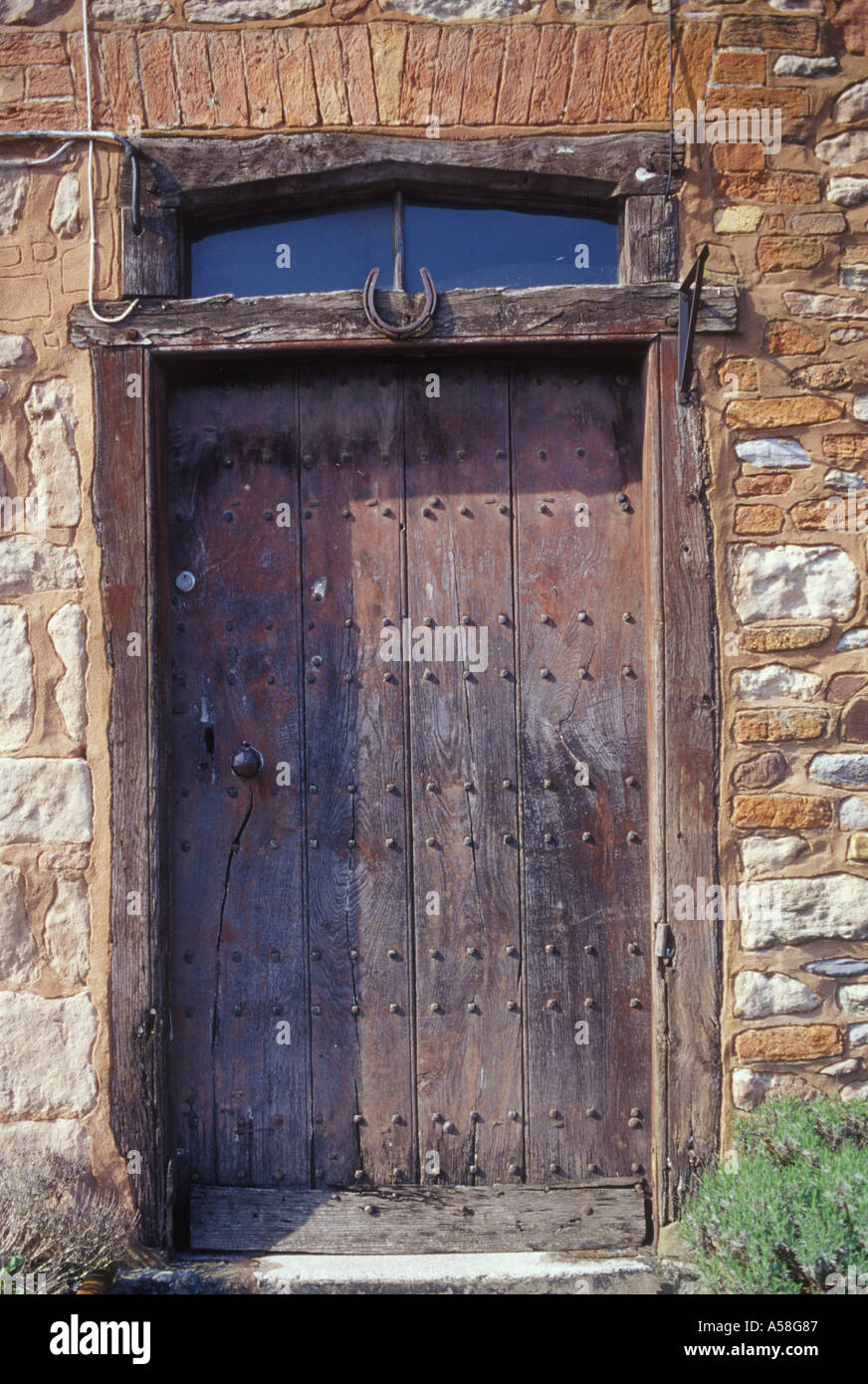 Charmant Old Boarded Studded Wooden Cottage Door Put Within Earlier Stone Frame  Lucky Horseshoe Nailed Above Nether Stowey Somerset UK