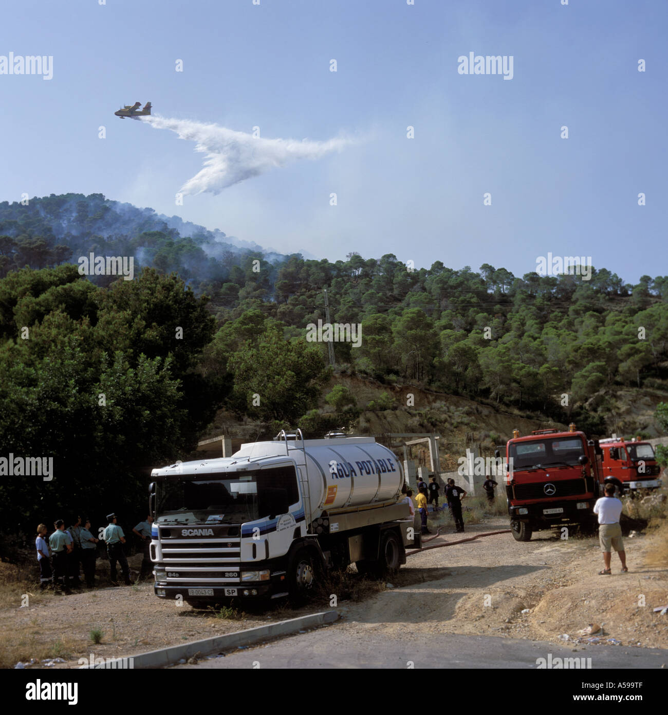 Canadair amphibious forest firefighting aircraft in operation + support operations at Paguera, Mallorca, Balearic Islands, Spain - Stock Image
