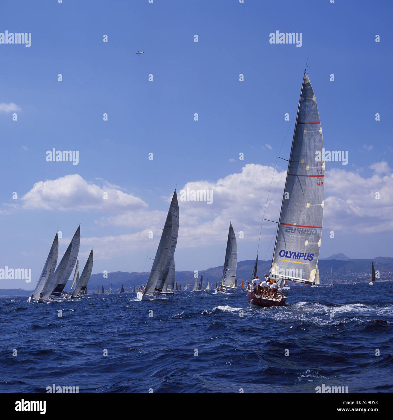 Scene with Olympus Orlando IMS 500 in the foreground during the 22nd Copa Del Rey Kings Cup Regatta 2003 in the Bay of Palma de - Stock Image
