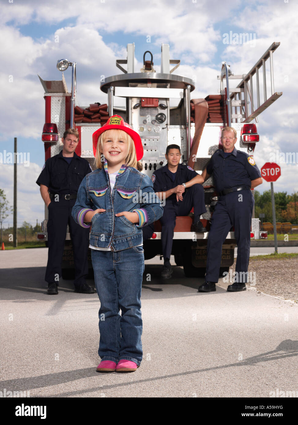 Portrait of Girl with Fire Fighters Stock Photo