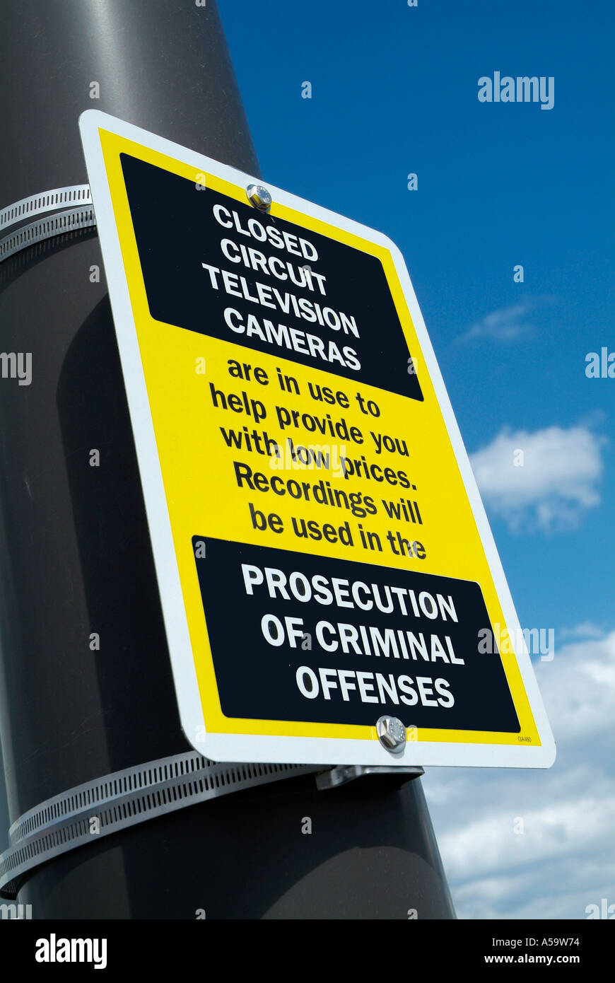 Closed circuit Television camera sign in the parking lot of a large business store - Stock Image