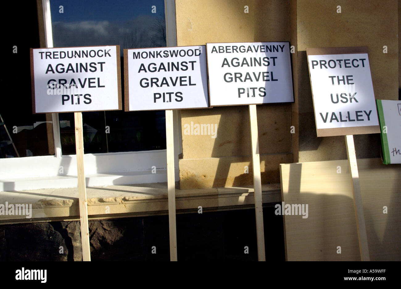 Placards at a protest against plans for gravel pits in the Usk Valley Monmouthshire Wales UK - Stock Image