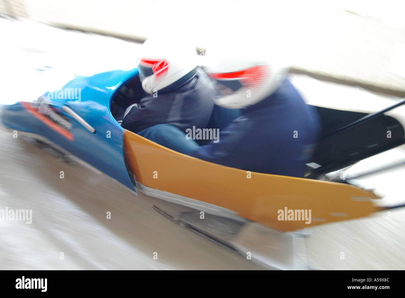 Bobsleigh speeding down the course at 100hm h Stock Photo