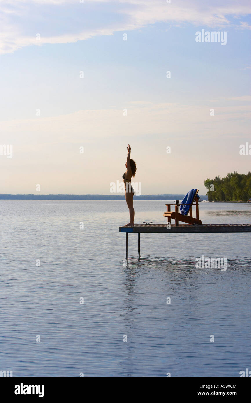 Woman Diving off of Dock Stock Photo