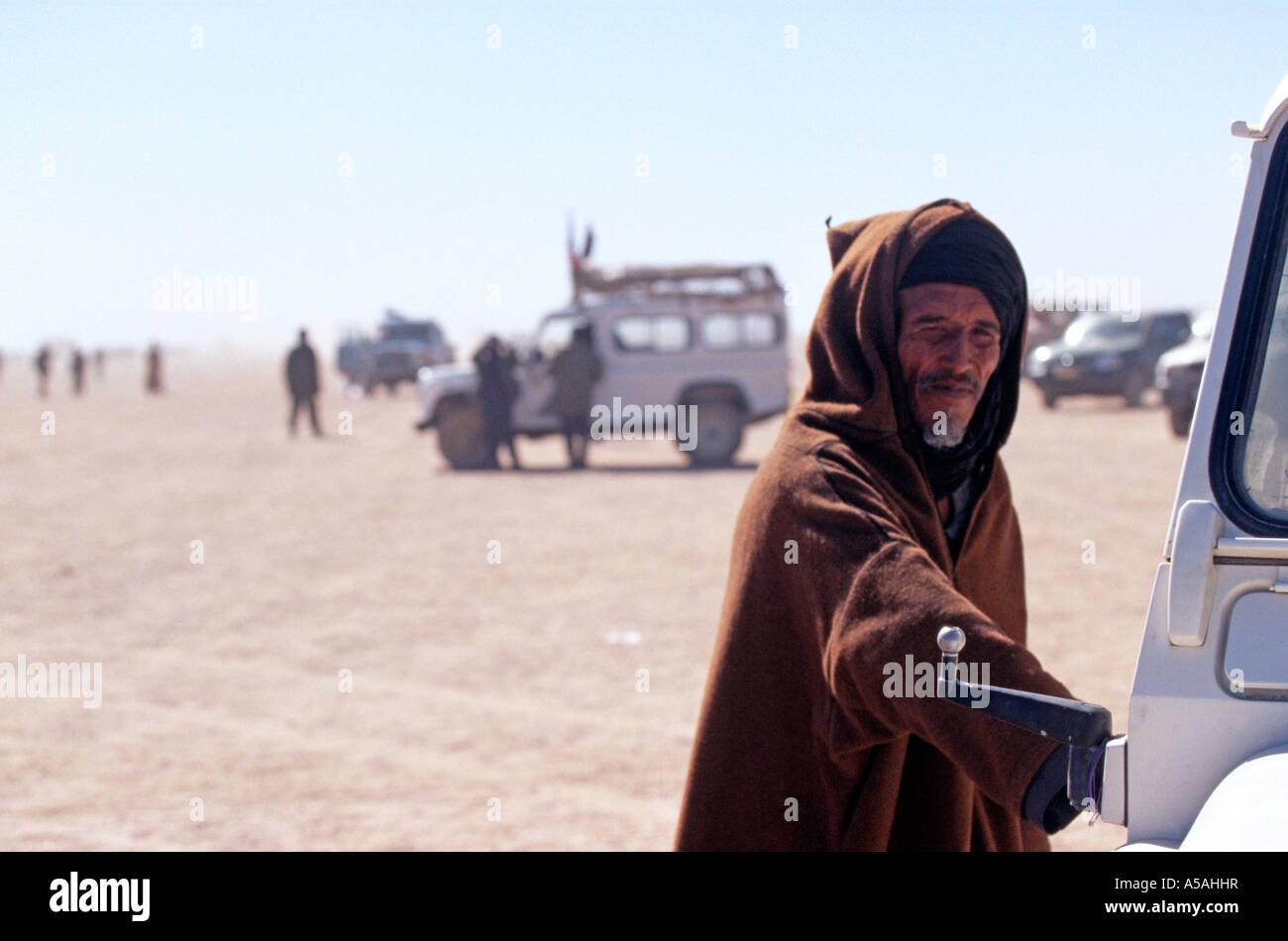 A Sahrawi man getting into his car in Tindouf Western Algeria - Stock Image