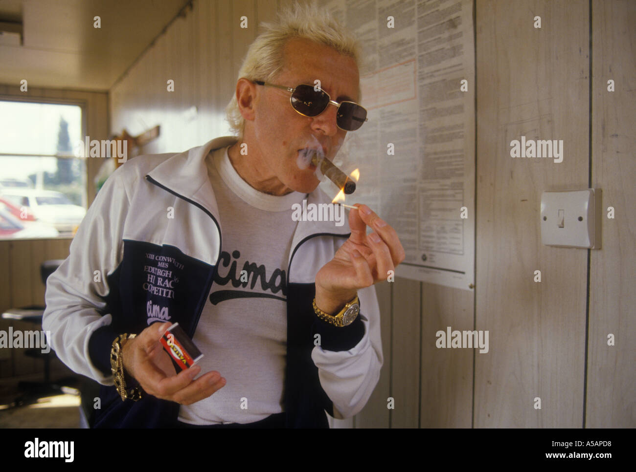 jimmy saville tv personality with lighting up his trade mark cigar