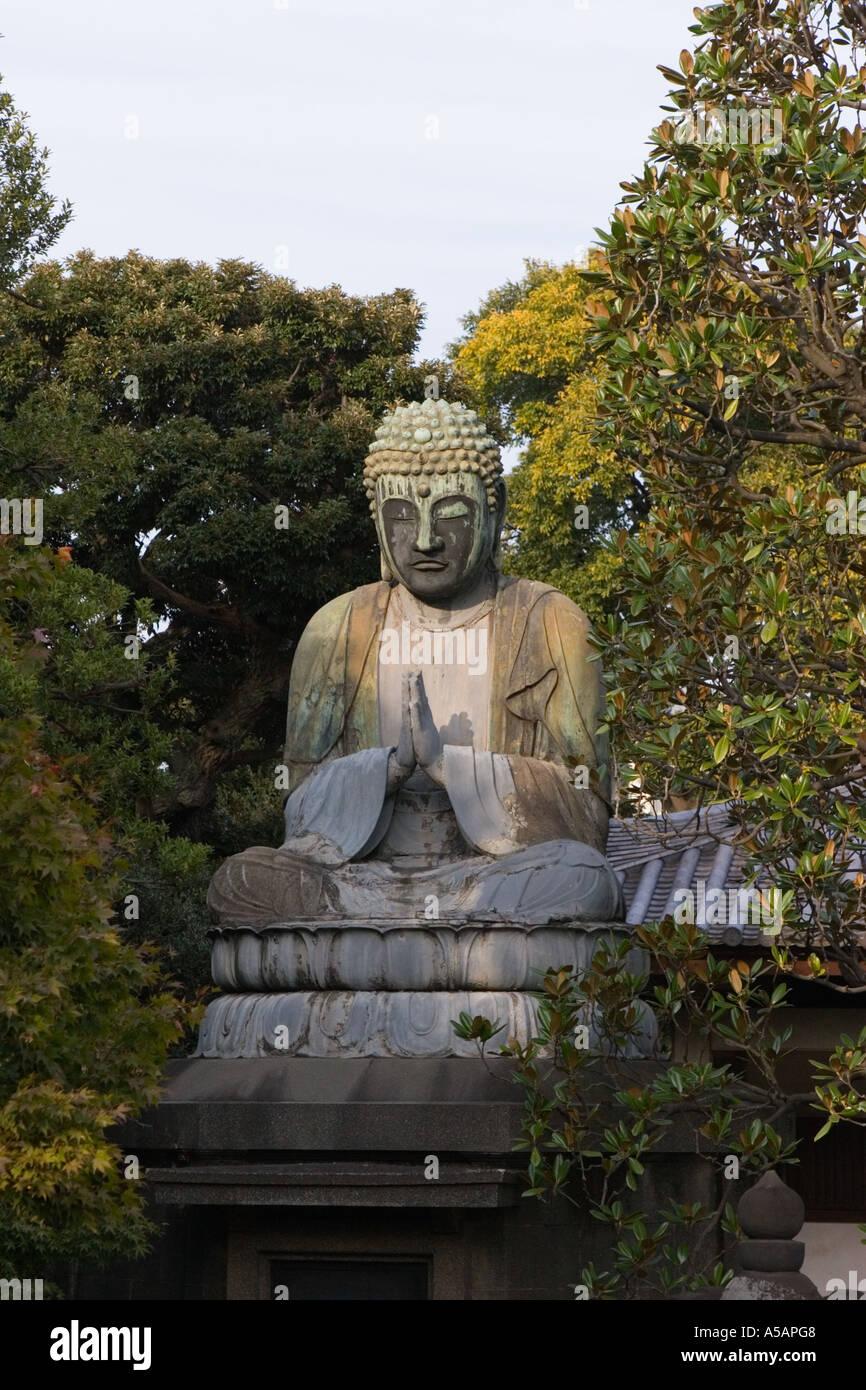 Copper seating figure of Buddha at Gokokusan Tenno ji Temple Taito city Tokyo Japan AsiaStock Photo