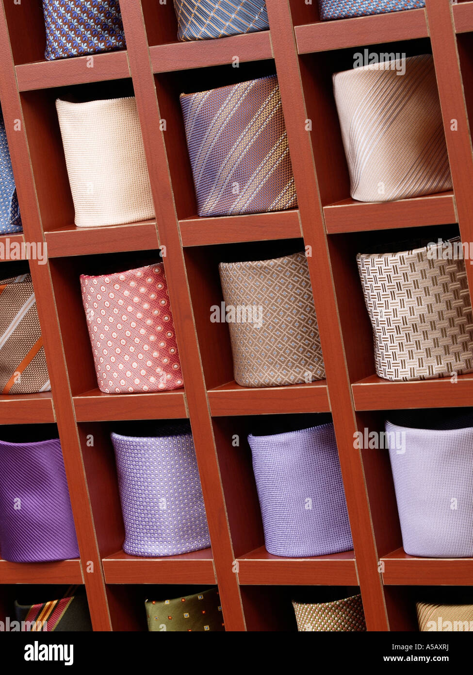 Display of ties mens fashion accessories shop rack shelves patterns colors trend suit clothes - Stock Image