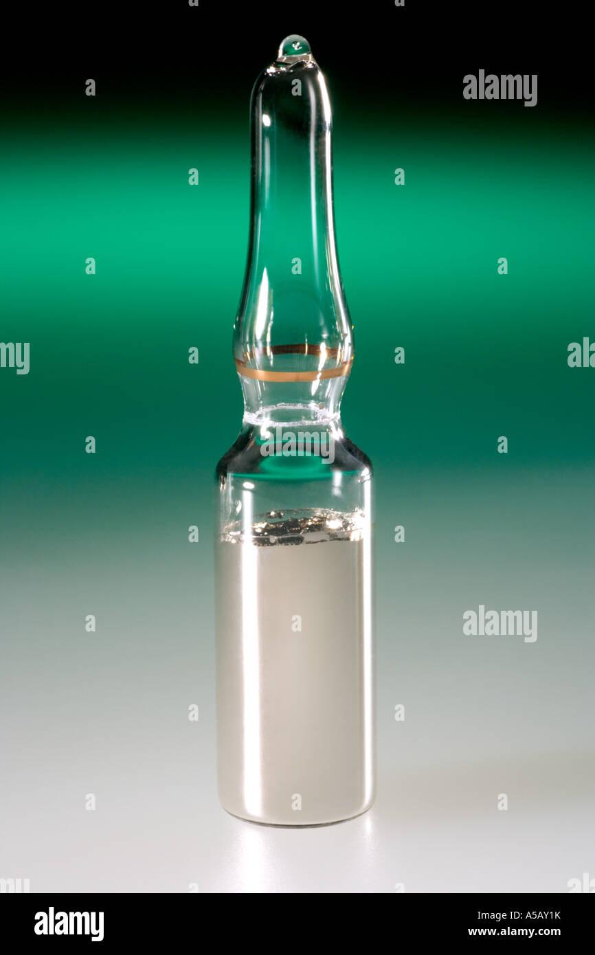 elemental rubidium in a glass ampoule under argon stock photo