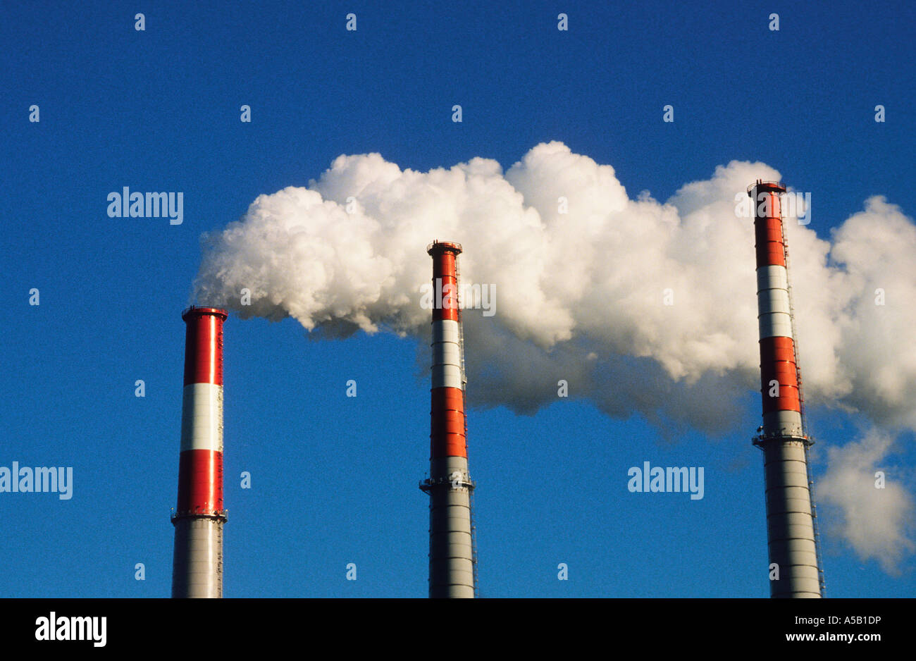 New York City NYC Three Smoke Stacks With Steam Coming Out - Stock Image