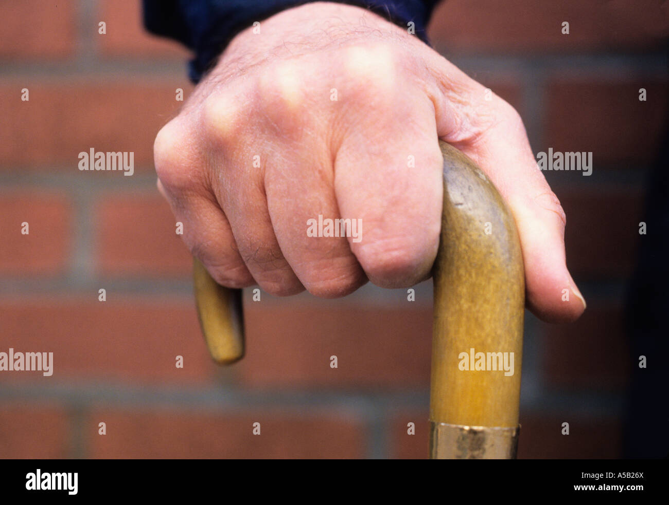 Man Holding a Cane Supporting Himself New York City USA - Stock Image