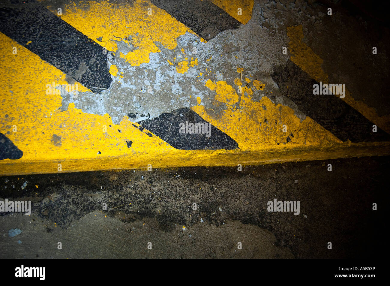 Black and yellow striped curb. - Stock Image
