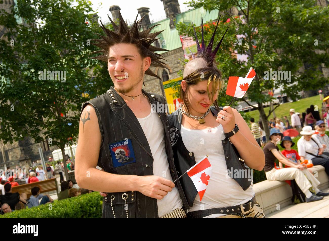 Two punk Canadians celebrating Canada Day. - Stock Image