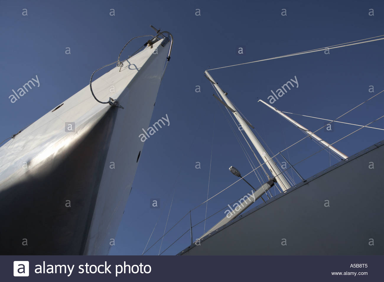 Yacht bow from bellow against clear blue sky - Stock Image