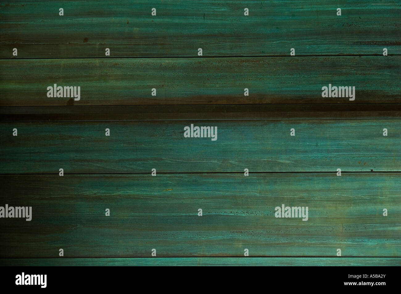 Green oxidized copper metal wall. - Stock Image