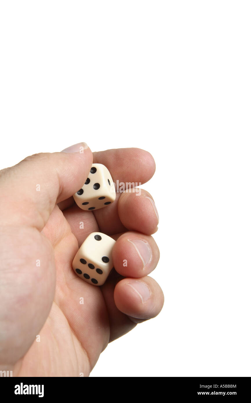 Rolling the Dice cut out on white background - Stock Image