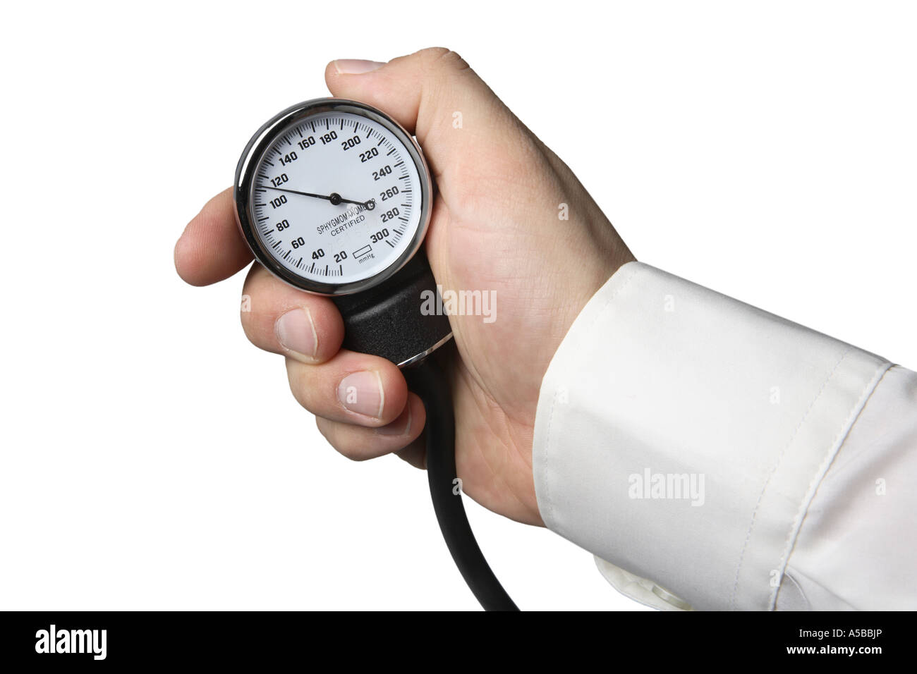 Hand holding blood pressure gauge cut out on white background - Stock Image