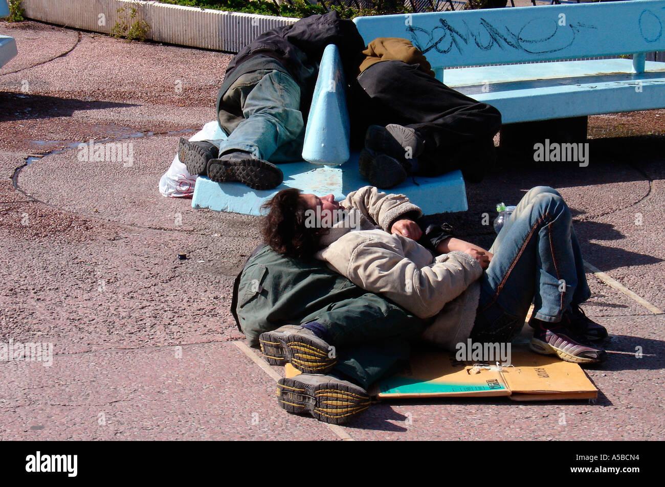 Drunk homeless people sleeping outdoors Tel Aviv Israel - Stock Image