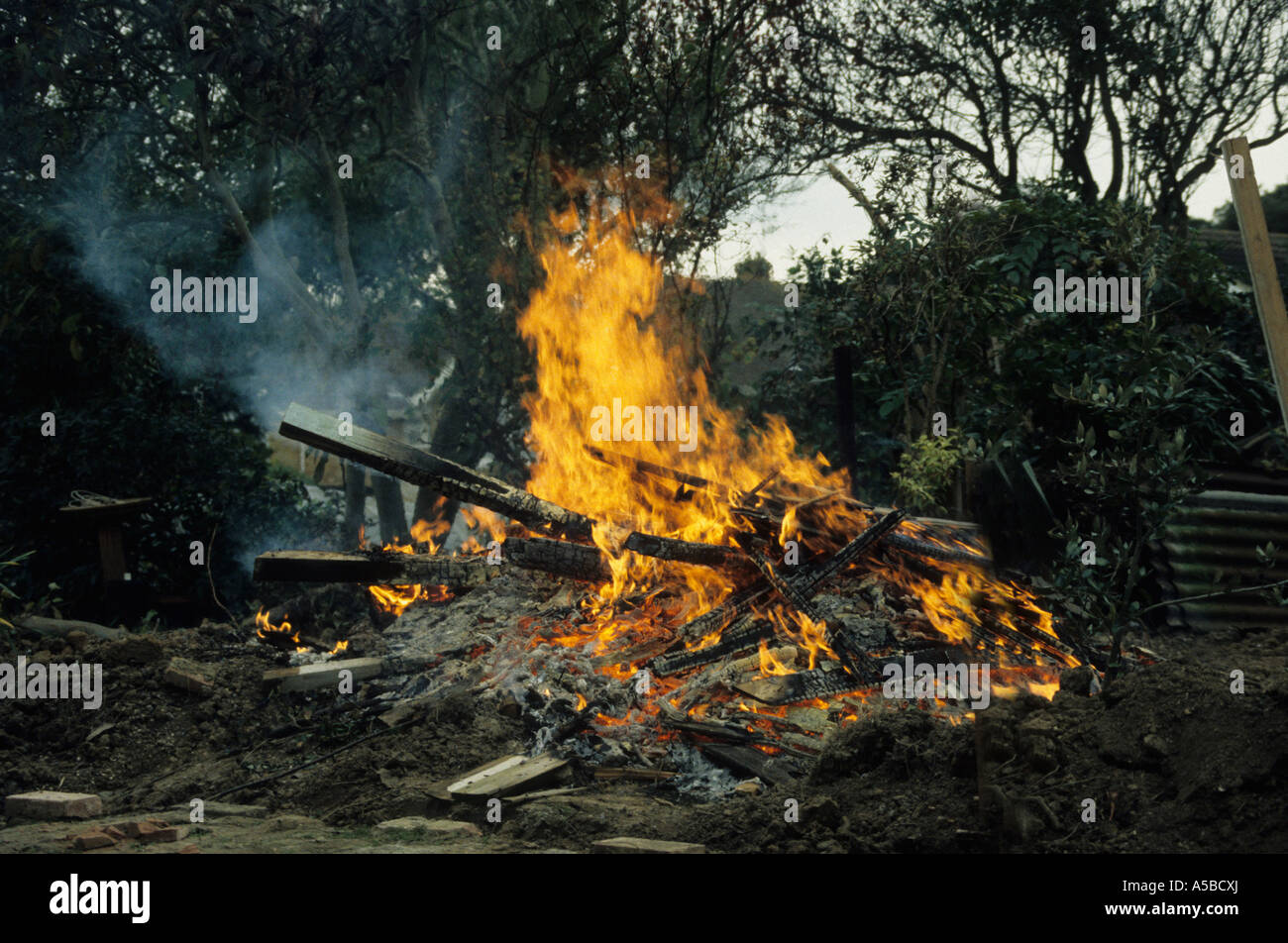 bonfire in garden polluting the air and sending out emmisions not helping with global warming Stock Photo