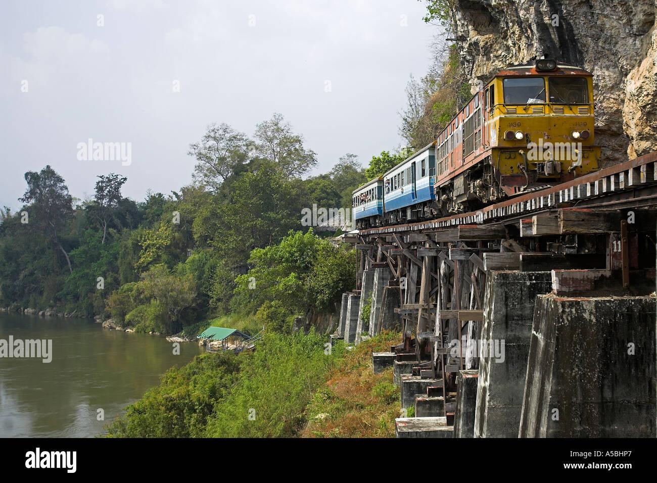 River Kwai and Burma Railway tourist train on Krasae Cave trestle railway viaduct bridge Thailand - Stock Image